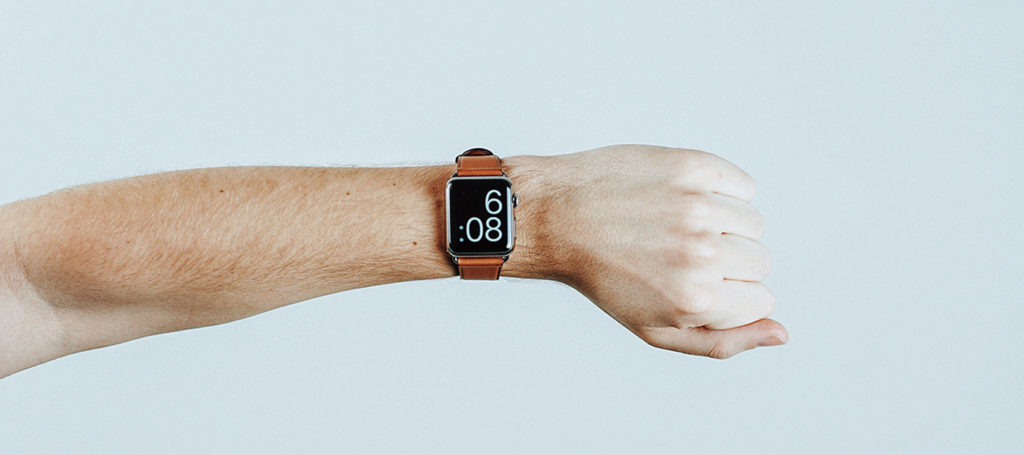 watch on an arm in time management tips for small businesses