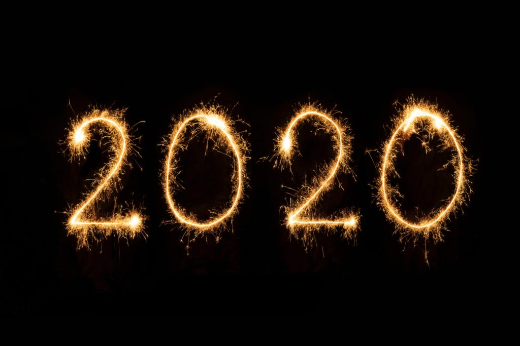 2020 written in air with sparklers - New Year's Marketing Ideas