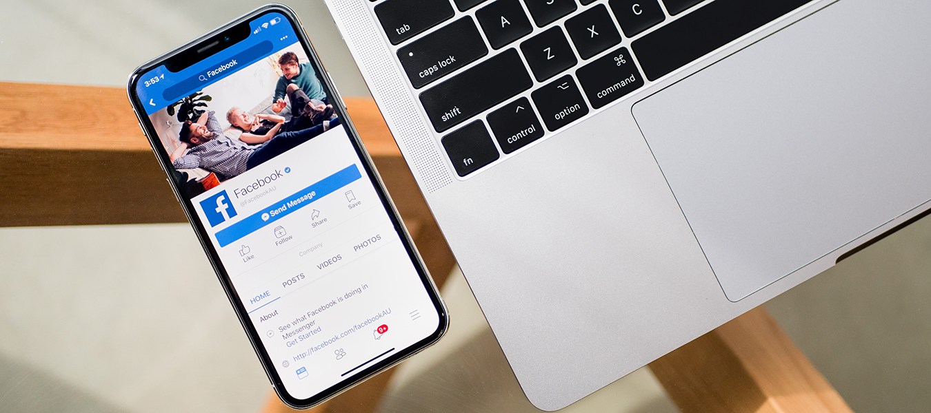 phone on glass table with Facebook pulled up -benefits of a business Facebook