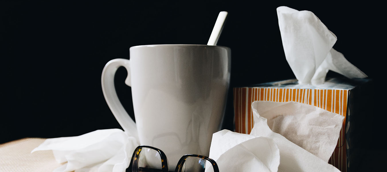 tissues, mug, glasses on a table - private label immune-boosting supplements